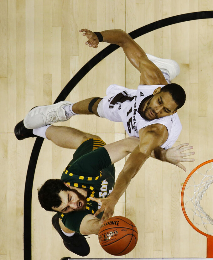 St. Bonaventure's LaDarien Griffin, top, defends George Mason's Jarred Reuter (31) shoots during the second half of an NCAA college basketball game in the Atlantic 10 men's tournament Friday, March 15, 2019, in New York. St. Bonaventure won 68-57. (AP Photo/Frank Franklin II)