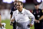 Alabama head coach Nick Saban jogs off the field after an NCAA college football game against Southern Mississippi, Saturday, Sept. 25, 2021, in Tuscaloosa, Ala. (AP Photo/Vasha Hunt)