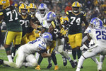 Green Bay Packers running back Aaron Jones (33) is tackled by Detroit Lions linebackers Alex Anzalone (34) and Jamie Collins Jr. (8) during an NFL football game on Monday, Sept. 20, 2021, in Green Bay, Wis. (Adam Niemi/The Daily Mining Gazette via AP)