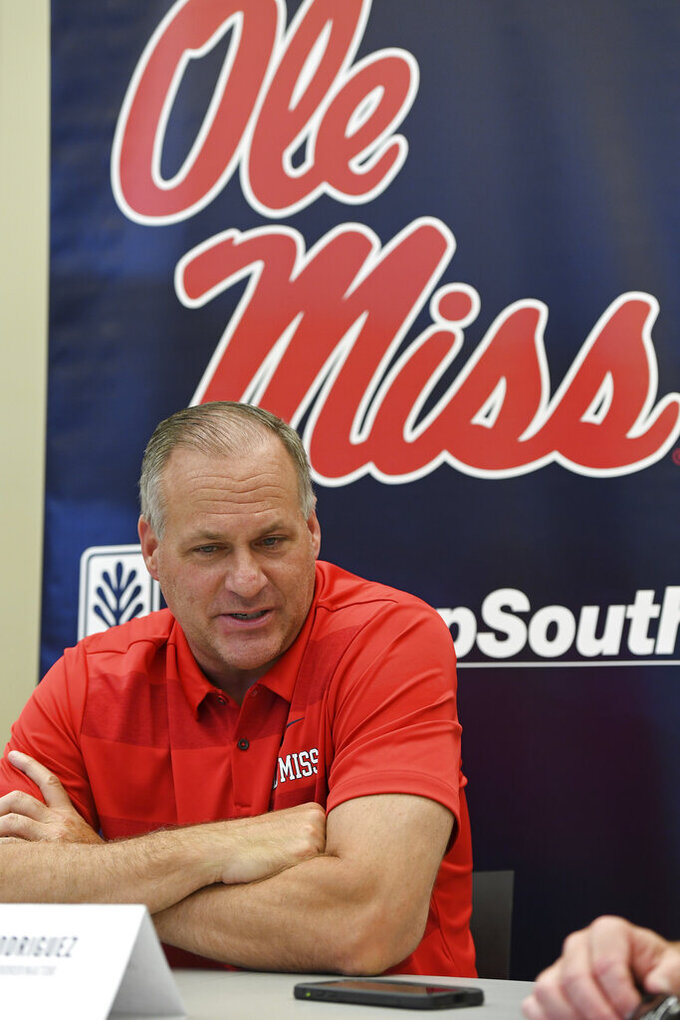 Mississippi offensive coordinator Rich Rodriguez talks during Mississippi's Media Day at the Manning Center in Oxford, Miss. on Thursday, Aug. 1, 2019. Mississippi begins NCAA college football practice on Friday and opens the season against Memphis on Aug. 31, 2019.  (AP Photo/Thomas Graning)