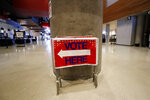 Election signs are stored at State Farm Arena, home of the NBA's Atlanta Hawks basketball team, Friday, July 17, 2020, in Atlanta. The 16,888-seat facility will be used as a poll location for the upcoming election. (AP Photo/John Bazemore)
