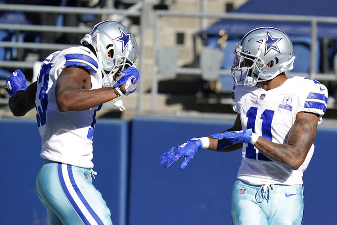 Dallas Cowboys wide receiver Ced Wilson, right, celebrates with wide receiver Michael Gallup, left, after Wilson scored a touchdown during the second half of an NFL football game against the Seattle Seahawks, Sunday, Sept. 27, 2020, in Seattle. (AP Photo/Elaine Thompson)