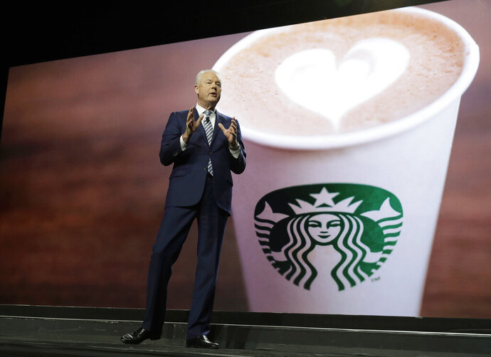 Starbucks CEO Kevin Johnson speaks Wednesday, March 20, 2019, at the company's annual shareholders meeting in Seattle. (AP Photo/Ted S. Warren)