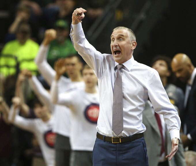 FILE - In this Feb. 28, 2019, file photo, Arizona State coach Bobby Hurley gestures to his team during the first half of an NCAA college basketball game against Oregon in Eugene, Ore. Arizona State should be able to play multiple styles in bid to reach three straight NCAA Tournaments for the first time since the early 1960s. The Sun Devils have key players back and Hurley added more talent through junior college transfers and recruiting. (AP Photo/Chris Pietsch, File)