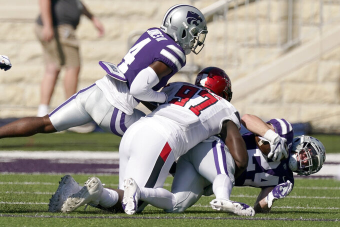 Kansas State defensive back Brock Monty (24) is tackled by Texas Tech defensive lineman Tony Bradford Jr. as he runs the ball after recovering a blocked Texas Tech punt during the first an NCAA college football game Saturday, Oct. 3, 2020, in Manhattan, Kan. (AP Photo/Charlie Riedel)