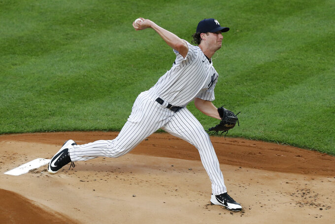 In his first regular season appearance, New York Yankees starting pitcher Gerrit Cole (45) delivers during the first inning of a baseball game against the Philadelphia Phillies, Monday, Aug. 3, 2020, at Yankee Stadium in New York. (AP Photo/Kathy Willens)