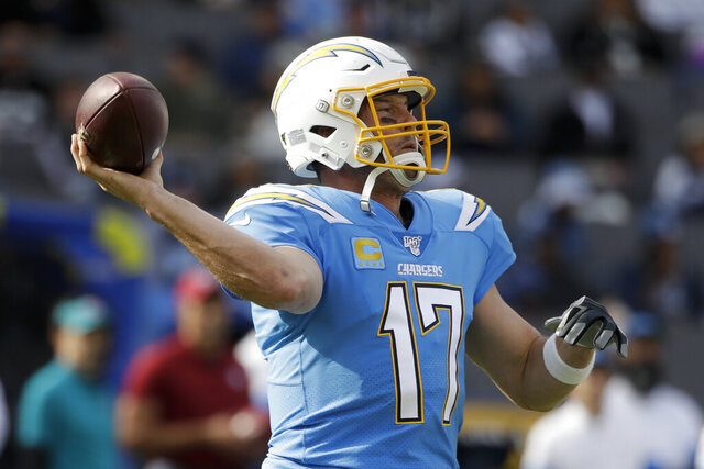 Los Angeles Chargers quarterback Philip Rivers passes against the Oakland Raiders during the first half of an NFL football game Sunday, Dec. 22, 2019, in Carson, Calif. (AP Photo/Marcio Jose Sanchez)
