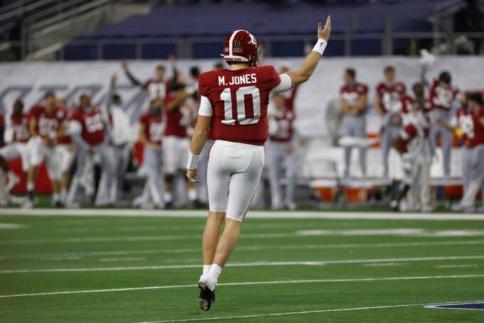 Alabama quarterback Mac Jones (10) celebrates throwing a touchdown pass to tight end Jahleel Billingsley (19) in the first half of the Rose Bowl NCAA college football game against Notre Dame in Arlington, Texas, Friday, Jan. 1, 2021. (AP Photo/Ron Jenkins)