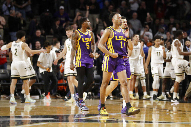 LSU guard Javonte Smart (1) leaves the court as Vanderbilt players celebrate after an NCAA college basketball game Wednesday, Feb. 5, 2020, in Nashville, Tenn. Vanderbilt upset LSU 99-90. (AP Photo/Mark Humphrey)