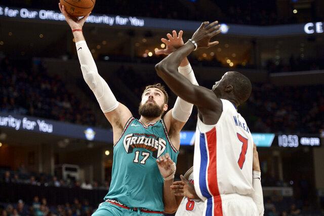 Memphis Grizzlies center Jonas Valanciunas (17) shoots against Detroit Pistons forward Thon Maker (7) in the second half of an NBA basketball game Monday, Feb. 3, 2020, in Memphis, Tenn. (AP Photo/Brandon Dill)