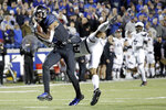 Memphis wide receiver Damonte Coxie, left, catches a 46-yard touchdown pass as he is defended by Cincinnati cornerback Cam Jefferies (14) in the second half of an NCAA college football game Friday, Nov. 29, 2019, in Memphis, Tenn. (AP Photo/Mark Humphrey)