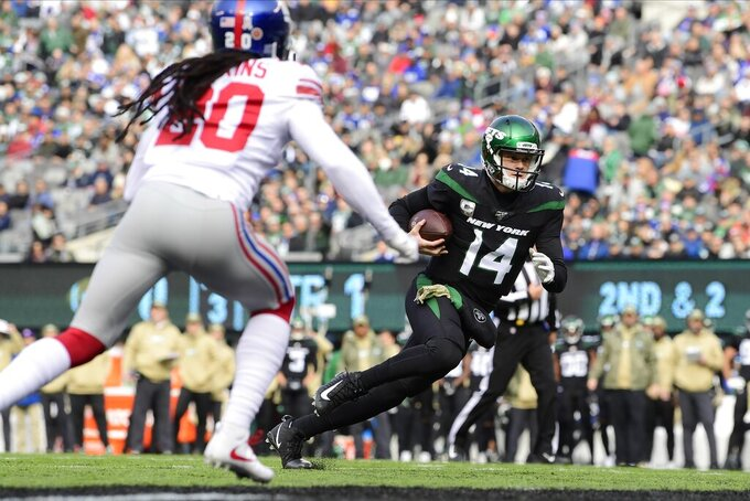 New York Jets quarterback Sam Darnold (14) runs past New York Giants' Janoris Jenkins (20) for a touchdown during the first half of an NFL football game Sunday, Nov. 10, 2019, in East Rutherford, N.J. (AP Photo/Steven Ryan)