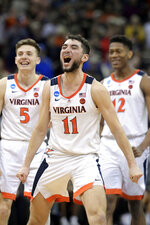 Virginia's Ty Jerome (11) celebrates with teammates Kyle Guy (5) and De'Andre Hunter (12) during overtime of the men's NCAA Tournament college basketball South Regional final game against Purdue, Saturday, March 30, 2019, in Louisville, Ky. Virginia won 80-75. (AP Photo/Timothy D. Easley)