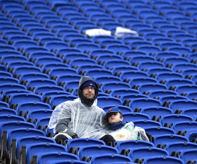 Two fans endure the cold and rain during an NCAA college football game between Duke and Wake Forest in Durham, N.C., Saturday, Nov. 24, 2018. (AP Photo/Ben McKeown)