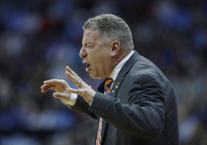 Auburn head coach Bruce Pearl is seen on the sidelines during the first half of a men's NCAA tournament college basketball Midwest Regional semifinal game against North Carolina Friday, March 29, 2019, in Kansas City, Mo. (AP Photo/Charlie Riedel)
