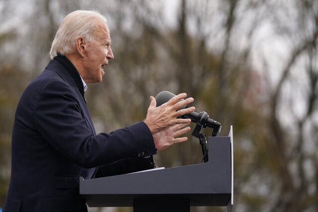 FILE - In this Dec. 15, 2020, file photo President-elect Joe Biden speaks at a drive-in rally for Georgia Democratic candidates for U.S. Senate Raphael Warnock and Jon Ossoff in Atlanta. (AP Photo/Patrick Semansky, File)