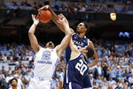 Yale forward Jordan Bruner (23) and forward Paul Atkinson (20) guard North Carolina forward Garrison Brooks (15) during the first half of an NCAA college basketball game in Chapel Hill, N.C., Monday, Dec. 30, 2019. (AP Photo/Gerry Broome)