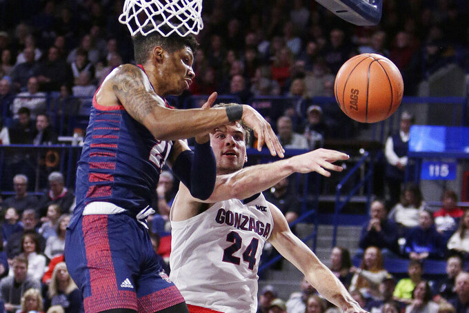 Detroit Mercy forward Chris Brandon, left, and Gonzaga forward Corey Kispert go after a rebound during the first half of an NCAA college basketball game in Spokane, Wash., Monday, Dec. 30, 2019. (AP Photo/Young Kwak)