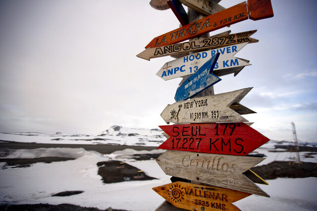FILE - In this Jan. 20, 2015 file photo, wooden arrows show the distances to various cities on King George Island, Antarctica. Amid an increase in COVID-19 infections in 2020, which has already left more than 20,000 dead in Argentina, scientists and military personnel living at the country's bases in Antarctica feel safe and fortunate on the only continent with no reported cases. (AP Photo/Natacha Pisarenko, File)
