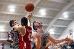Boston University's Sukhmail Mathon (41) battles for a rebound between Colgate's Rapolas Ivanauskas 925) and Will Rayman (10) in the second half of the NCAA Patriot League Conference basketball championship at Cotterell Court, Wednesday, March 11, 2020, in Hamilton, N.Y. (AP Photo/John Munson)
