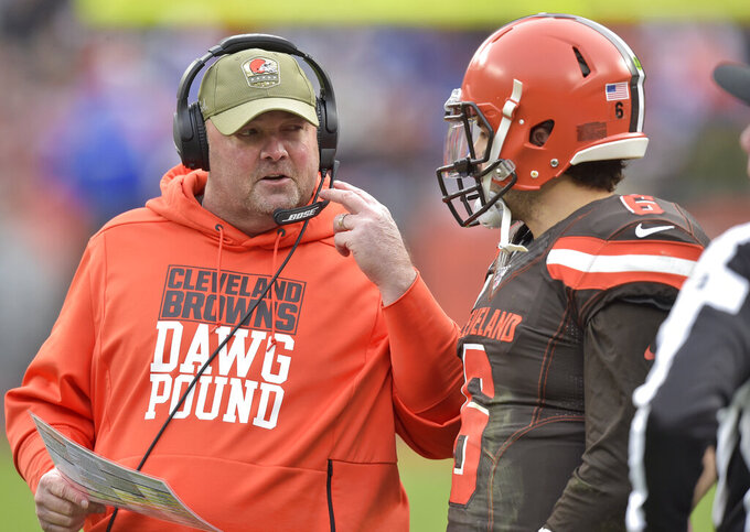 Cleveland Browns head coach Freddie Kitchens, left, talks with quarterback Baker Mayfield during the second half of an NFL football game against the Buffalo Bills, Sunday, Nov. 10, 2019, in Cleveland. (AP Photo/David Richard)