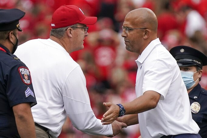 Wisconsin head coach Paul Chryst shakes hands with Penn State head coach James Franklin after an NCAA college football game Saturday, Sept. 4, 2021, in Madison, Wis. Penn State won 16-10. (AP Photo/Morry Gash)
