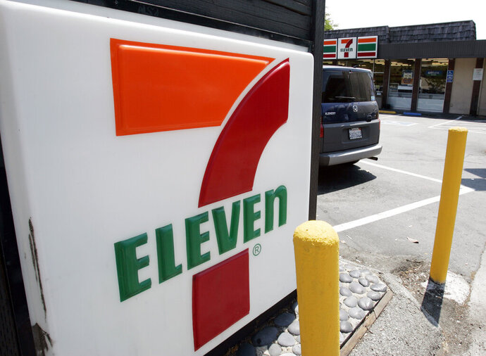 FILE - In this July 1, 2008 file photo, a 7-Eleven is shown in Palo Alto, Calif. The convenience-store chain is launching a service that lets customers order everything from its trademark frozen drink to a battery charger and have it delivered to a public place like a park or a beach.  The retailer told The Associated Press that more than 2,000 7-Eleven