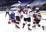 New Jersey Devils' Jack Hughes, right, celebrates his goal against the New York Rangers during the second period of an NHL hockey game Tuesday, Jan. 19, 2021, in New York. (Bruce Bennett/Pool Photo via AP)