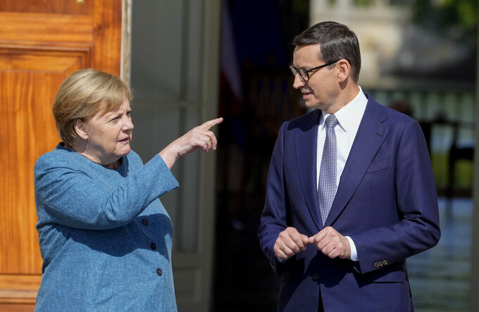 German Chancellor Angela Merkel, left, gestures as she meets Poland's Prime Minister Mateusz Morawiecki in Warsaw, Poland, Saturday, Sept.11, 2021.Merkel is visiting the Polish capital Morawiecki at a time when Poland faces migration pressure on its eastern border with Belarus. (AP Photo/Czarek Sokolowski)