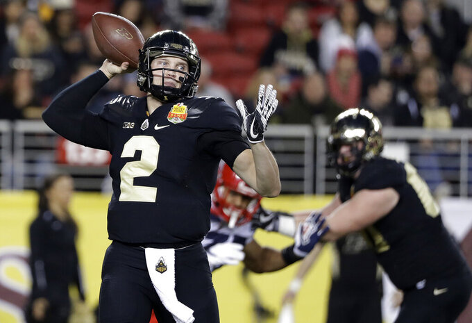 FILE - In this Dec. 27, 2017, file photo, Purdue quarterback Elijah Sindelar (2) throws against Arizona during the first half of the Foster Farms Bowl NCAA college football game in Santa Clara, Calif. For the first time in three years, Elijah Sindelar isn't battling his close friend, David Blough, for the starting quarterback job.   (AP Photo/Marcio Jose Sanchez, File)