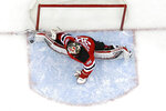 New Jersey Devils goaltender Cory Schneider blocks a shot from St. Louis Blues left wing David Perron during the first period of an NHL hockey game, Saturday, March 30, 2019, in Newark, N.J. (AP Photo/Julio Cortez)