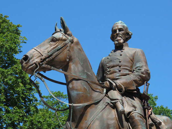 FILE - In this Aug. 18, 2017, file photo, a statue of Confederate Gen. Nathan Bedford Forrest sits in a park in Memphis, Tenn. Relatives of Confederate general Nathan Bedford Forrest are demanding $30 million from the city of Memphis and a nonprofit to move his remains from a Tennessee park and settle a lawsuit over the takedown of a statue of the former Ku Klux Klan leader. (AP Photo/Adrian Sainz, File)