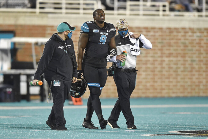 Coastal Carolina defensive end Tarron Jackson walks off of the field after an injury during the first half of an NCAA college football game against BYU Saturday, Dec. 5, 2020, in Conway, S.C. Jackson was selected to The Associated Press All-America first-team defense, Monday, Dec. 28, 2020. (AP Photo/Richard Shiro)
