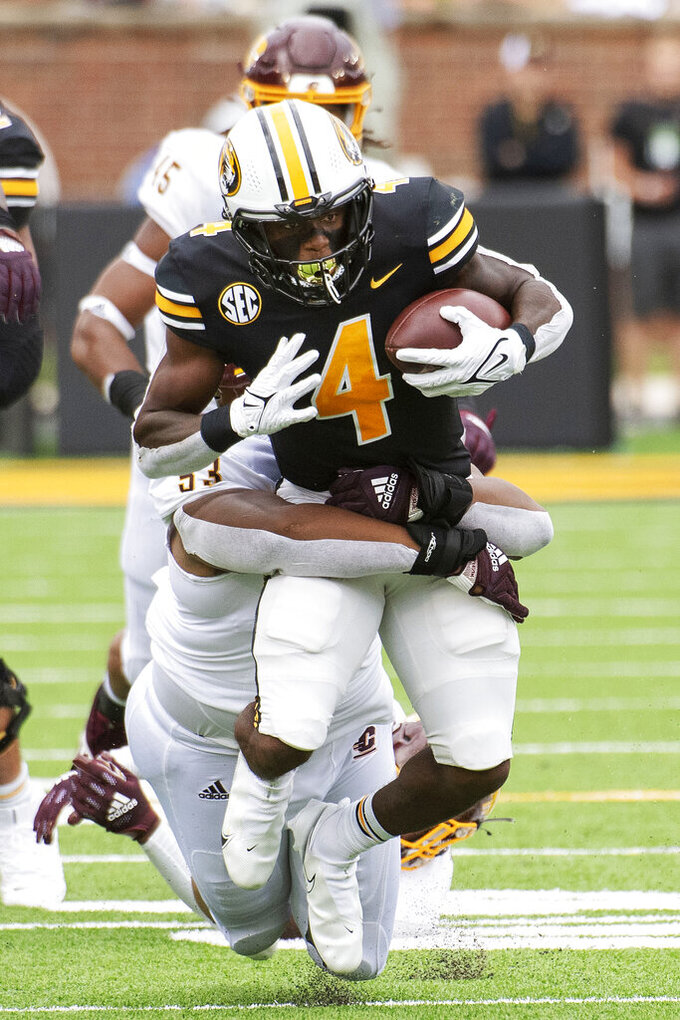 Missouri running back Elijah Young (4) is tackled by Central Michigan defensive lineman Jason Williams during the first half of an NCAA college football game Saturday, Sept. 4, 2021, in Columbia, Mo. (AP Photo/L.G. Patterson)