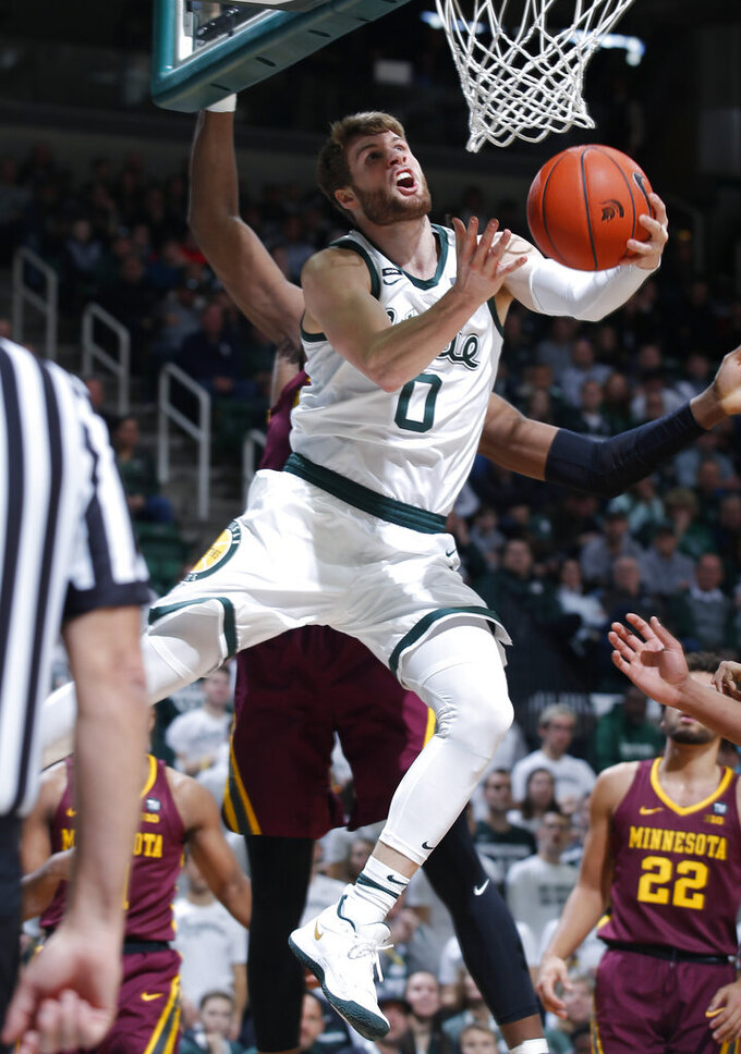Michigan State's Kyle Ahrens (0) goes to the basket against Minnesota during the first half of an NCAA college basketball game, Saturday, Feb. 9, 2019, in East Lansing, Mich. (AP Photo/Al Goldis)
