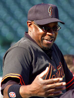FILE - In this Oct. 11, 2002, file photo, San Francisco Giants manager Dusty Baker gestures during practice at Pac Bell Park in San Francisco. In 1993, Baker's Giants went 103-59 but missed the playoffs by a single game after a memorable division race with the Atlanta Braves (there were no wild cards in those days). Over 22 years, Baker has guided four teams to the playoffs and notched 1,863 wins. But his career is marred by its postseason failures. (AP Photo/Elaine Thompson, File)