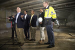 House Transportation and Infrastructure Committee Chair Peter DeFazio, D-Ore., left, is joined by MTA Chief Development Officer Janno Lieber, right, and Rep. Adriano Espaillat, D-N.Y., third from right, during a news conference in a subway tunnel originally built in the 1970s, and stopped when the project ran out of money, that will be repurposed for the current 2nd Avenue subway project in New York, Friday, May 3, 2019. The increasing challenges posed by the New York area's aging rail infrastructure came into sharp focus Thursday as a congressional delegation prepared to get a firsthand look at the country's busiest station on the same day commuters learned about summer schedule disruptions due to track repairs. (AP Photo/Mary Altaffer)