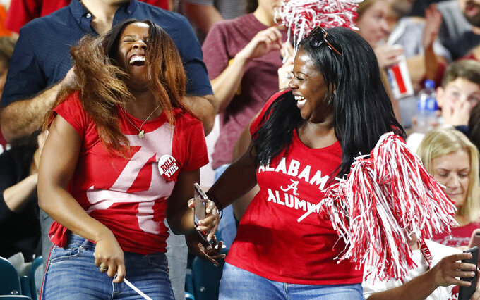 Alabama fans celebrate, during the first half of the Orange Bowl NCAA college football game against Oklahoma , Saturday, Dec. 29, 2018, in Miami Gardens, Fla. (AP Photo/Wilfredo Lee)