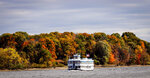 """FILE - This Wednesday Oct. 22, 2008 file photo shows tour boat """"Becky Thatcher"""" cruising up the Connecticut River in Chester, Conn. Connecticut tourism officials plan to spend more money than usual promoting the state's fall foliage in an attempt help the industry rebound from the pandemic. (AP Photo/Bob Child, File)"""