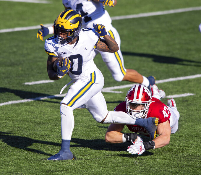 Indiana linebacker Micah McFadden (47) is kicked in the face while trying to stop Michigan wide receiver Giles Jackson (0) as he runs the ball up field during the second half of an NCAA college football game Saturday, Nov. 7, 2020, in Bloomington, Ind. Indiana won 38-21. (AP Photo/Doug McSchooler)
