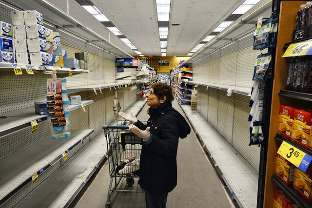 A gloved grocery shopper is dismayed over empty shelves at a local Ralphs supermarket in an attempt to stock up on supplies, Friday, March 13, 2020, in the Panorama City section of Los Angeles. Officials said Friday the  Los Angeles Unified School District and San Diego school districts will close starting March 16 because of the coronavirus threat. The vast majority of people recover from the new coronavirus. According to the World Health Organization, most people recover in about two to six weeks, depending on the severity of the illness. (AP Photo/Richard Vogel)