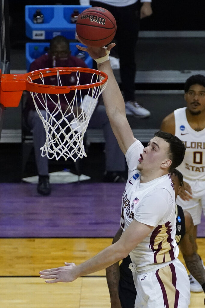 Florida State center Balsa Koprivica (5) takes a shot during the second half of a second-round game against Colorado in the NCAA college basketball tournament at Farmers Coliseum in Indianapolis, Monday, March 22, 2021. (AP Photo/Charles Rex Arbogast)