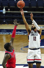 UConn forward Tyler Polley (12) shoots against St. John's in the first half of an NCAA college basketball game in Storrs, Connecticut, Monday, Jan. 18, 2021.  (David Butler II/Pool photo via AP)