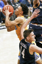 Pittsburgh's Trey McGowens, left, drives to the hoop as Notre Dame's Nate Laszewski (14) defends during the first half of an NCAA college basketball game, Saturday, March 9, 2019, in Pittsburgh. McGowens was called for charging on the play. (AP Photo/Keith Srakocic)
