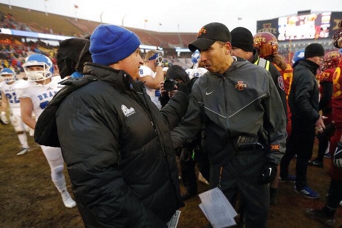 Drake head coach Rick Fox, left, talks with Iowa State head coach Matt Campbell after an NCAA college football game, Saturday, Dec. 1, 2018, in Ames, Iowa. Iowa State won 27-24. (AP Photo/Charlie Neibergall)