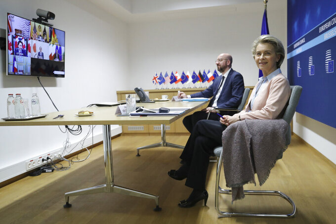 European Commission President Ursula von der Leyen, right, and European Council President Charles Michel prepare to take part in an online meeting of G7 leaders at the European Council building in Brussels, Friday, Feb. 19, 2021. (Olivier Hoslet, Pool via AP)