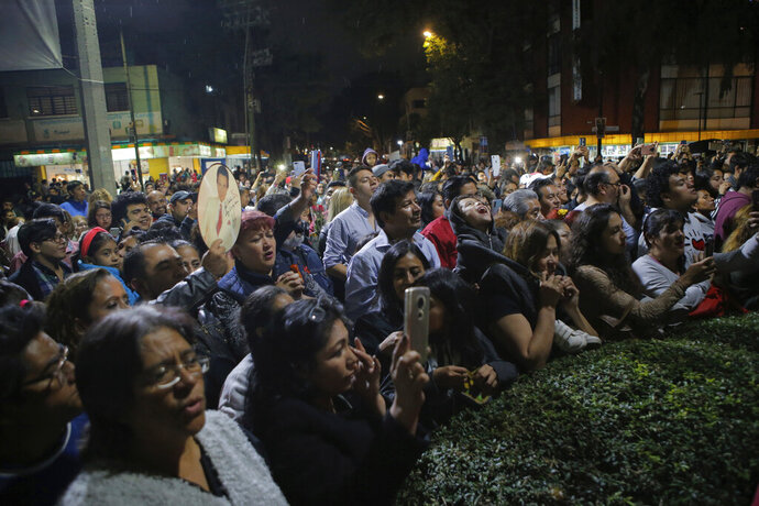 Fans gather to sing and remember Jose Jose while mourning his death at Jose Jose's statue in Mexico City, Saturday, Sept. 28, 2019. Mexican crooner Jose Jose, the elegant dresser who moved audiences to tears with melancholic love ballads and was known as the