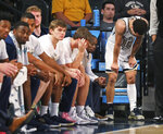 Georgia Tech guard Jose Alvarado, right, and teammates react in the final seconds of a loss to Notre Dame during an NCAA college basketball game Wednesday, Jan. 15, 2020, in Atlanta. (Curtis Compton/Atlanta Journal-Constitution via AP)
