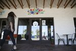 In this Friday, Oct. 18, 2019 photo, is the entrance of Earth Plant Based Cuisine vegan Mexican restaurant in Phoenix. No longer just a few items on a mainstream restaurant's menu, vegan Mexican food has become a widening industry on its own with Latinos taking control of the kitchen. (AP Photo/Ross D. Franklin)