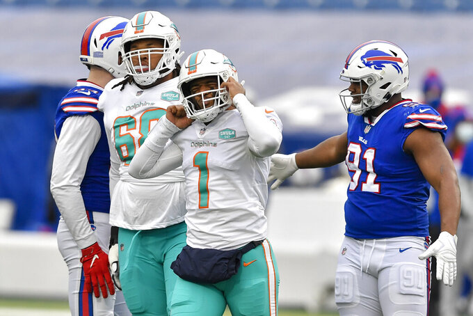 Miami Dolphins quarterback Tua Tagovailoa (1) reacts after being sacked in the first half of an NFL football game against the Buffalo Bills, Sunday, Jan. 3, 2021, in Orchard Park, N.Y. (AP Photo/Adrian Kraus)